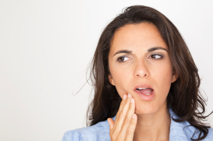 Brunette woman with tooth ache hand on mouth