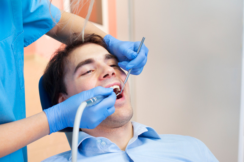 Man getting his teeth cleaned.  Middle Creek Dental - Nampa, ID